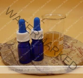 platter with 2 blue bottles and a beaker containing Sananga, Tabernaentana Undalata, Tabernaentana Sahanho