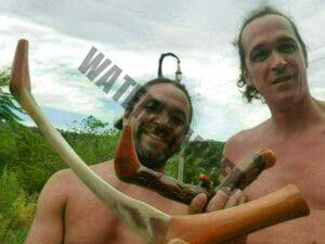 2 people showing a wood and a bone tepi
