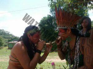 Indigenous women recieving Rapé sansara from tribal leader