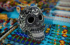 huichol bead-art skull on top of huichol bracelets