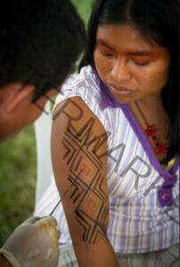 Kaxinawa woman getting kene applied on her arm