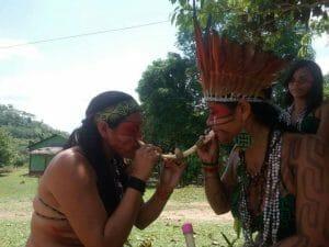 Indigenous women recieving Rapé Kaxinawa from tribal leader